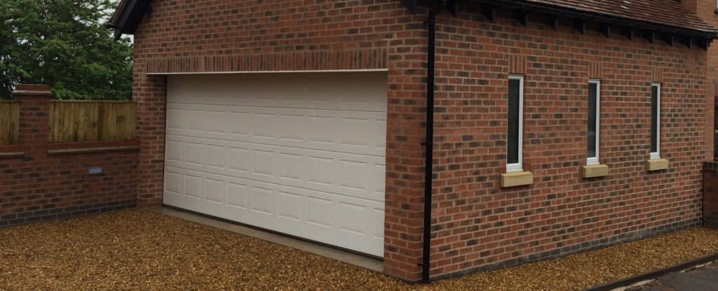 Steel sectional garage doors