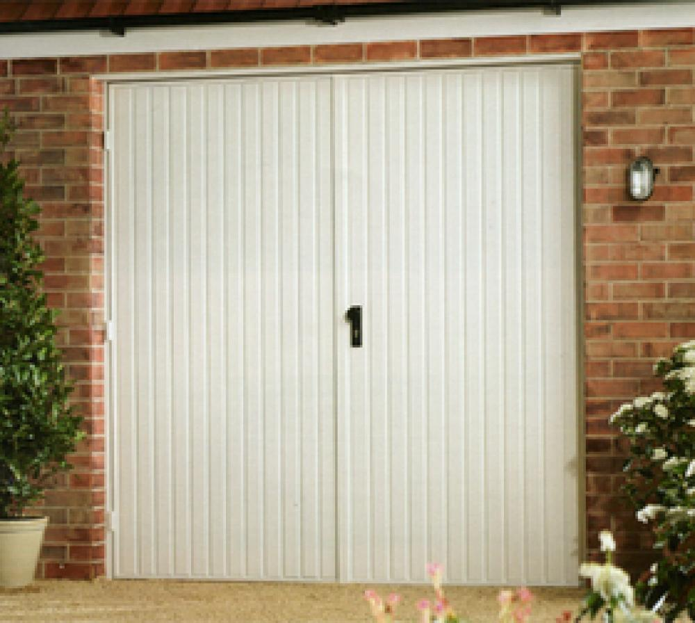 Steel side hinged garage doors for Garage side entry door