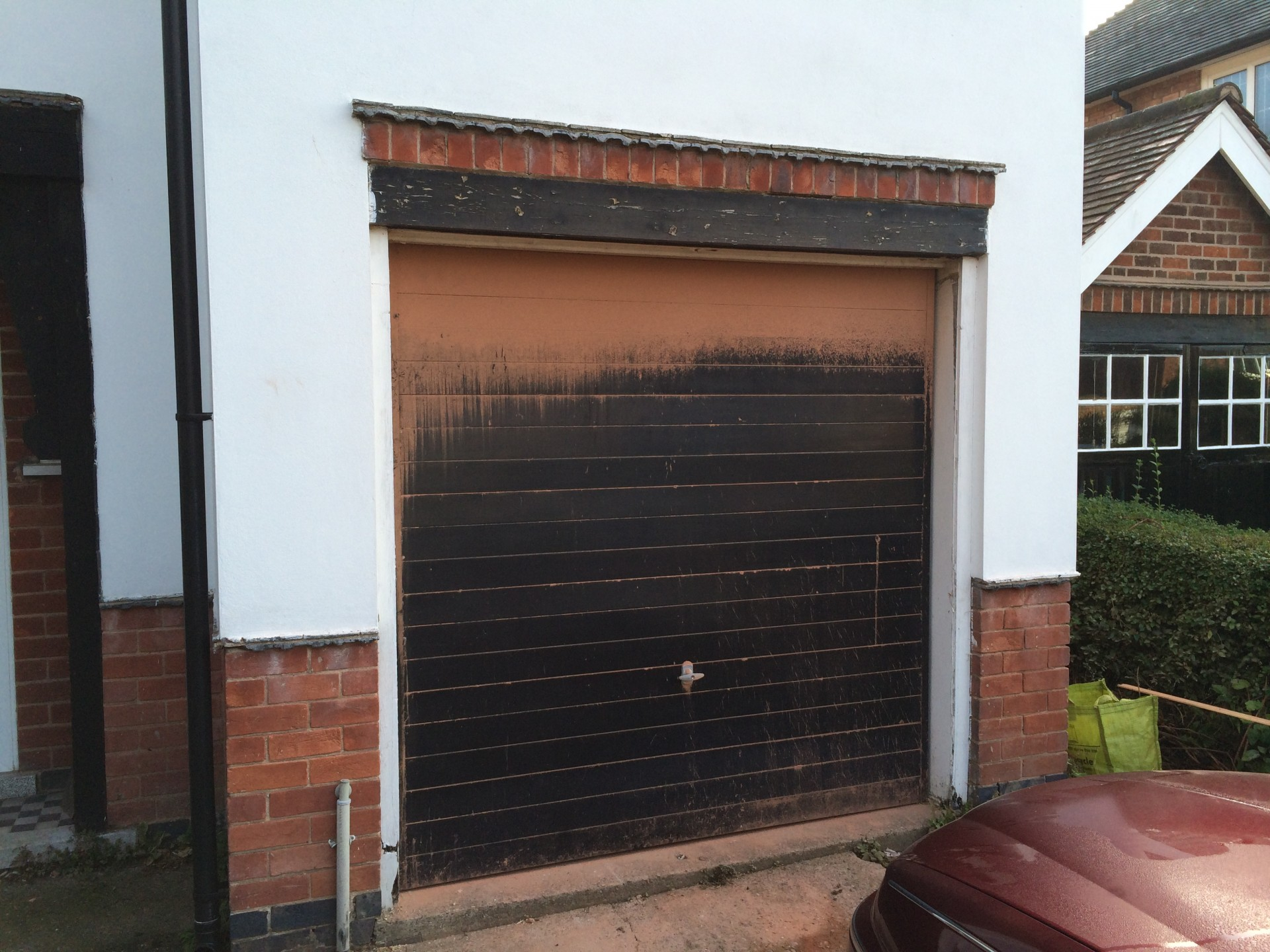 1440 #8C563F Black Is The New Black. pic Black Steel Garage Doors 36511920