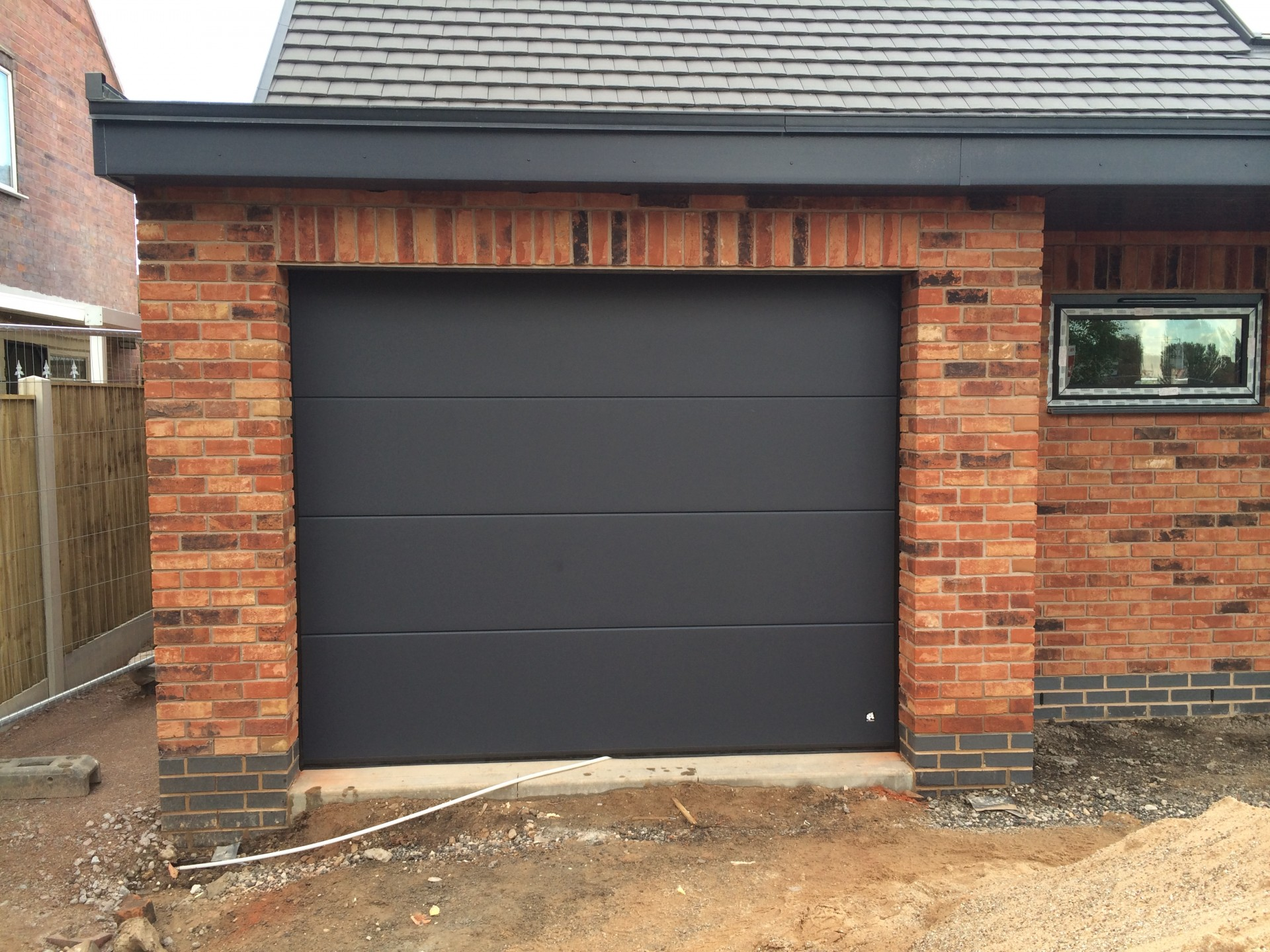 1440 #9C6C2F Byron Doors Ryterna Steel Sectional Garage Door In Smooth Anthracite  pic Sectional Steel Garage Doors 35911920